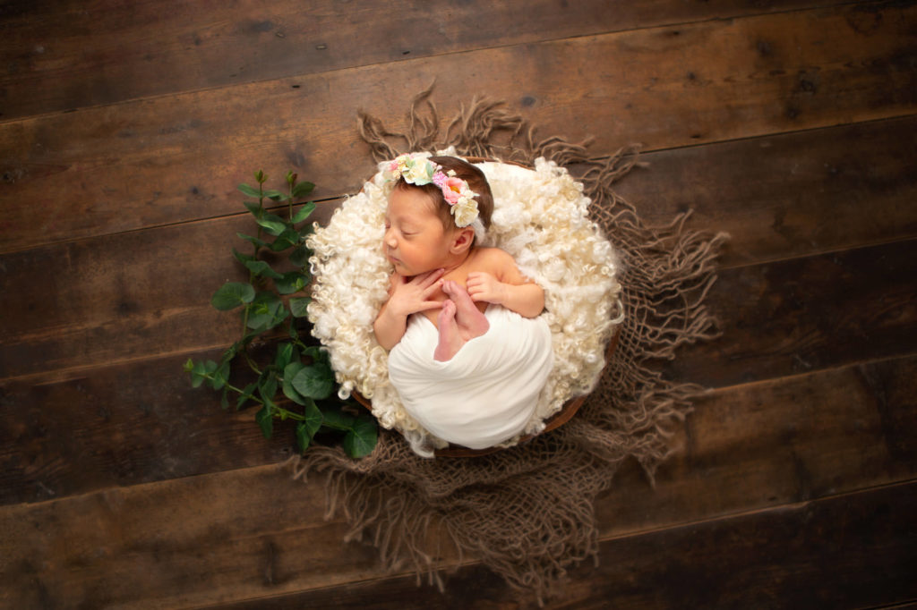 Girl wrapped up in a bowl, Caerphilly Newborn Photographer