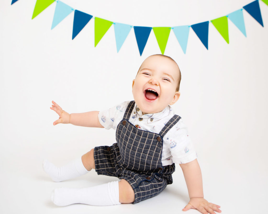 a little boy laughing with a lovely smile