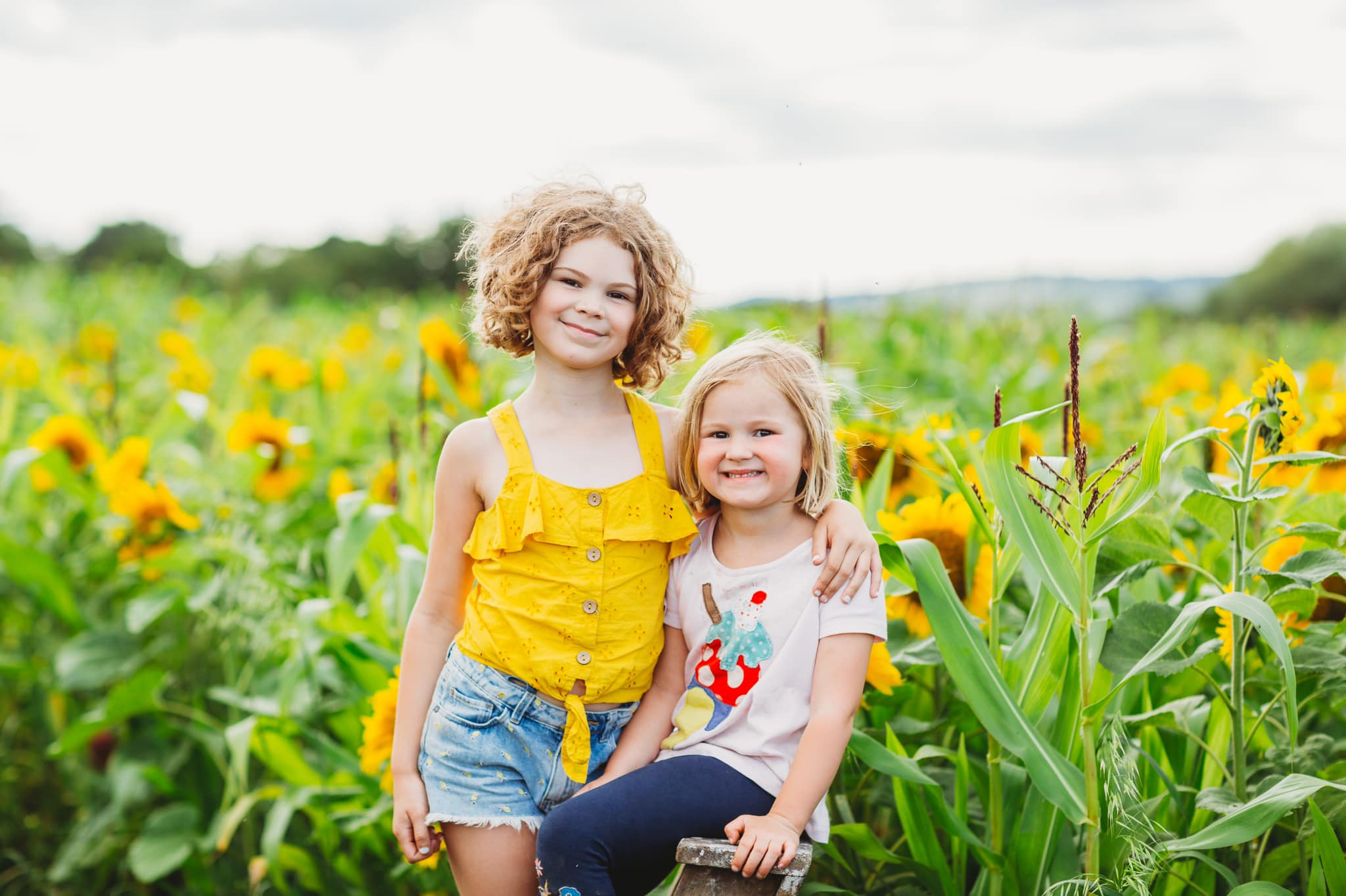 sisters in sunflowers